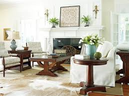 room with white furniture. Elegantly Carved Hardwood Furniture Dominates The Living Room, But White Covered Sofa Highlights It Room With