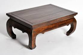 this lanna thai coffee table is made from reclaimed teakwood