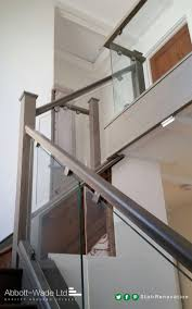 Abbott-Wade stained oak staircase with glass balustrade.