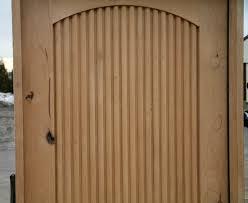 rustic wood doors has fluted panel design