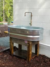 garden sinks. Stock Tank Sink. Pallet Wood Base. Garden Sinks