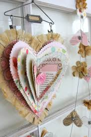 vintage valentine decor ~ could use old cards, sheet music, scrapbook  paper, and long arm stapler on center.