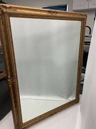 gold accent wood framed mirror
