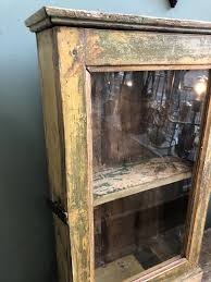 old wooden medicine cabinet with glass door home