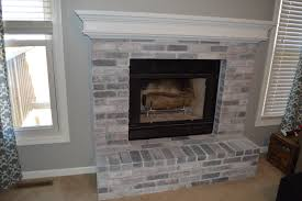 how to whitewash brick fireplace finished upstairs fireplace and mantle
