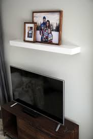 Easy to make modern floating shelf out of 1x3s and 1/4