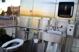 glass walled public toilet vies