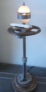 originally a smoking side table i started with the smoke and mirror idea slumping a piece of streaky white and clear glasounting it in one of the