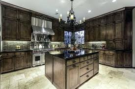 kitchen dark cabinets traditional kitchen with dark wood cabinets rustic wrought iron chandelier and honed floors