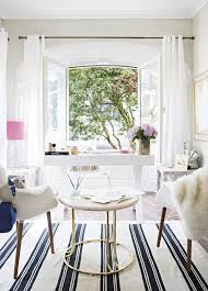 white airy home office. light and airy this modern home office is filled with crisp clean whites a jaunty striped rug on the floor white