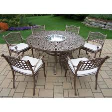 7 piece aluminum outdoor dining set with table 4 stackable cast aluminum arm chairs