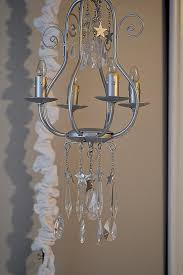 elegant adding crystals to a chandelier
