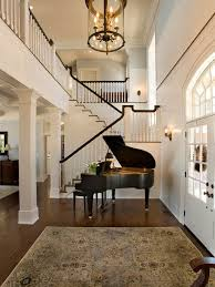 suzie mitch wise design two story foyer with grand piano in foyer with tan