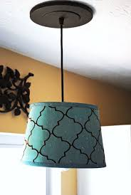 it is at the perfect height thanks to the adjule cord and it really pops against the white in the kitchen it takes a chandelier style light