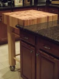red wooden small butcher block island with trundle and kitchen chopping block trolley