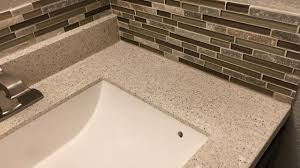 installing a glass mosaic tile backsplash in the bathroom