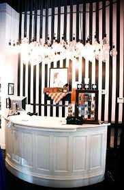 beauty salon lighting. beauty salon recptionstripe wallpaper lighting as a focal point