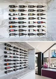 Wine Rack Ideas   Show Off Your Bottles With A Wall Mounted Display | The  Colorful Labels And Different Shapes Of The Bottles Stand Out Against The  White ...