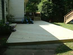 how do you lay wood flooring how to lay deck flooring on a concrete patio with deck over