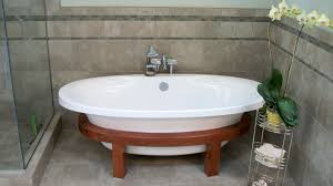 freestanding bathtub with wood stand