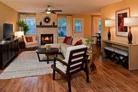 ashley furniture austin living room contemporary with area rug bohemian brick fireplace ceiling fan curtain panels