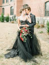 moody autumn wedding inspiration with a black wedding dress