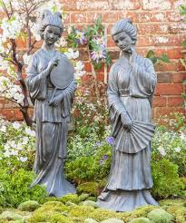 weather lady with fan garden statue