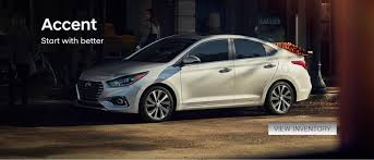 a white 2018 hyundai accent parked on a city street