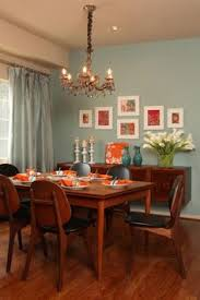 dining room colors grubb blue orange dining room i just really like the mounted buffet table on the wall and of course the calla lilies