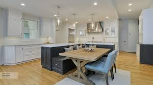 Kitchen Featuring an Island with Bench Seating