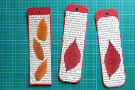making bookmarks with pressed leaves and pages from an old book