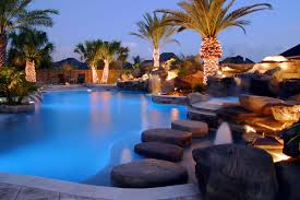 Custom Backyard Pool Designs Custom Boulder Rock Swimming Pool Featuring Outdoor Lights