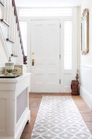 contemporary hallway runners create an entryway thatu0027s light and airy with a statement making rug