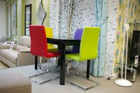 bright chairs and colourful shelves for a fun living room bright coloured furniture