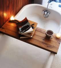 elegant soaking tubs with bathtub caddy for modern bathroom design