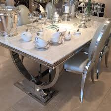 cream marble and chrome dining table with u shaped legs