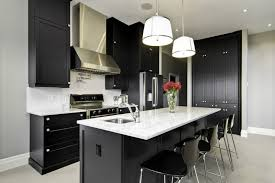 black and white kitchen grey wall white backsplash and countertop black cabinets black kitchen island black