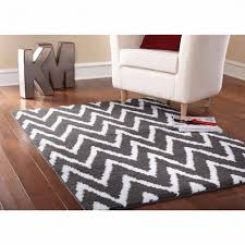 bedroom white and black stripes modern rug white foam sofa brown varnished wooden floor 47 cool