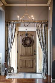 barn front doorcurtains over the front door add privacy and style Chandelier by
