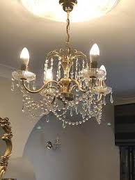 crystal chandelier with matching wall lights and table lamp