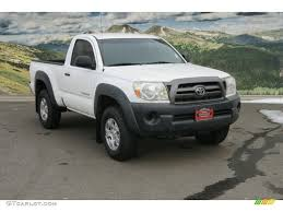 Silver Toyota Tacoma Lifted - image #4