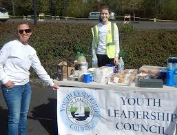 and management yst jenny slepian and youth leadership council co chair isabelle cullen stand behind the council s table at lake oswego s shred day
