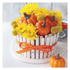 We used fresh billy balls and mums with our mini pumpkins, but if you use  dried flowers, you can keep the arrangement indefinitely.