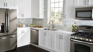 stainless steel home depot kitchen appliance packages with white wooden kitchen cabinet also stone tile