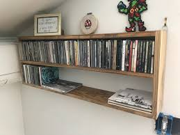 I decided to build a CD rack to hang on the wall so I could have a place to  display my collection instead of hiding them in a closet.