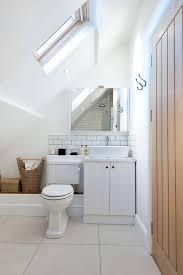 sloped ceiling cabinets. Delighful Ceiling Small Bathroom Under Slanted Ceiling With White Toilet Cabinet  Sink Tiling Floor Backsplash Of What Simple Yet  With Sloped Ceiling Cabinets K