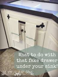 Tile Under Kitchen Cabinets What To Do With That Fake Drawer Under Your Kitchen Sink Kitchen