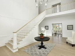two story entry with round foyer table
