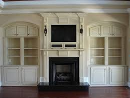 stunning cost for built in bookcase of bookshelves around fireplace cream wall shelves cabinets with cupboards next to units tv entertainment building