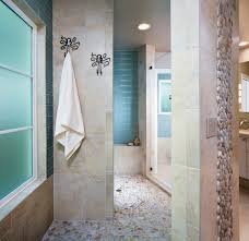 stunning contemporary tile walls bathroom is glass tile shower bench with pebble tile towel hooks clear glass shower door tile accent bathroom features
